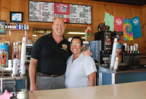 Dave and Jennette Calvert are picture behind the counter at Carolina BBQ. Photo by Ken Ketchie.