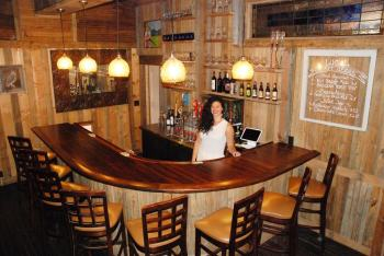 Bar Manager Morgan Hockaday is pictured in the new tavern at the Old Hampton Store.