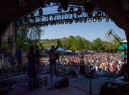 MerleFest draws thousands of fans to the Watson Stage each day of the four-day event. And Scythian is always popular on the Watson Stage. Photo by Billy Potter.