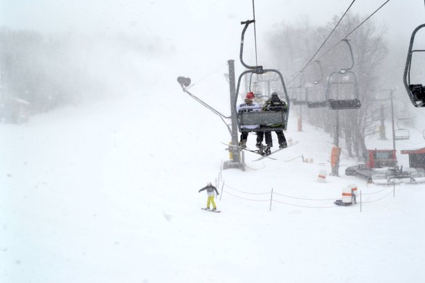 Two folks ride the ski lift on Friday morning at Appalachian Ski Mtn. Photo by Drew Stanley