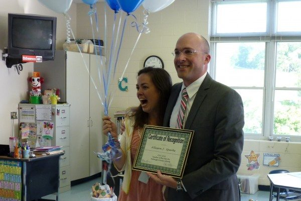 WCS Supt. Scott Elliott presents Allison Sparks with award on Friday morning.