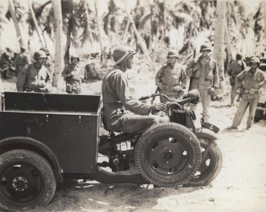 A Marine drives a Japanese Motor Tricycle recovered on Makin Island. circa 1943.