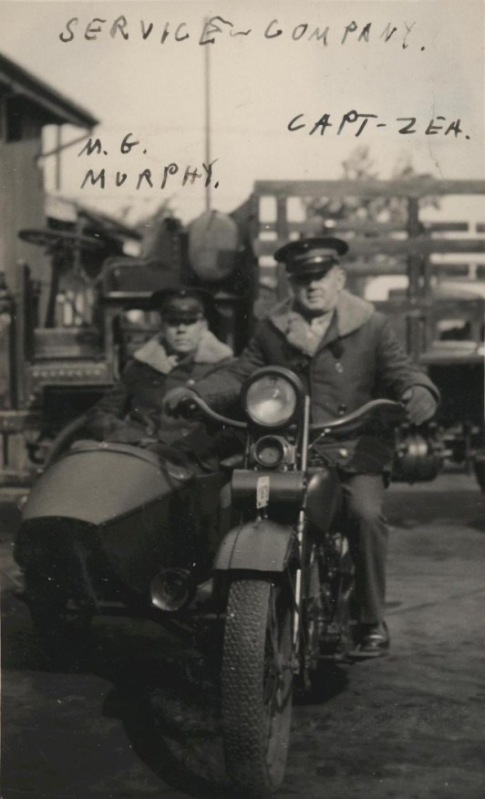 Thomas Murphy and Captain Sherman Zea pose for a photograph on a motorcycle in Shanghai, China, where they were members of the Service Company, 4th Marines, circa 1935.