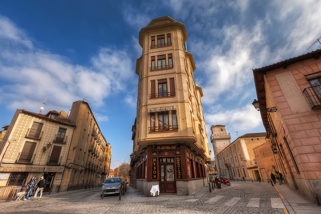 Street in SegoviaNot only streets are narrow in Spain. Also some of their buildings :). This is somewhere in Segovia, I will probably have to search Google maps a lot to find the exact place.HDR from three shots, taken with Canon 5D mark II with Canon 16-35mm F2.8 lens, from a tripod.