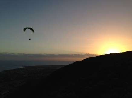 Soaring with the sunset at Hermanus - paragliding