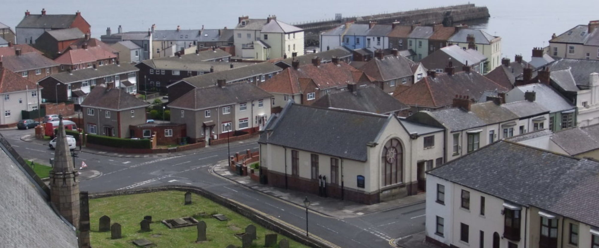 A view from St Hilda's Church Steeple showing the area to the right of the grave yard showing the new Chapel building.