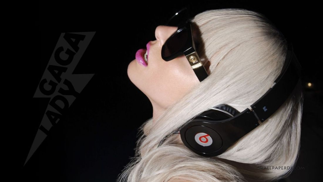 Lady Gaga wearing Monster Beats Studio wired headphones