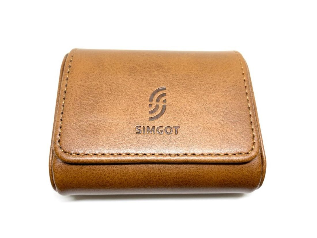 The leather case in the box.