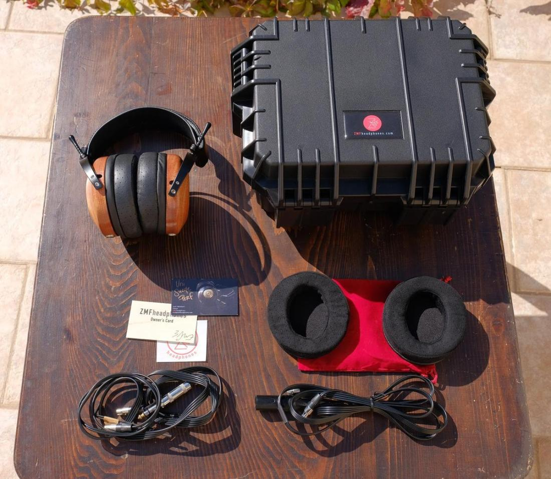 Aeolus headphones, Pelican seahorse case, XLR & 1/4 inch cables, warranty card and Universe suede ear pads