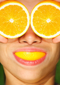 Funny picture of woman with orange.