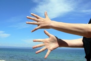 Hands and Beach Setting