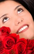 Photo of a beautiful woman with red roses