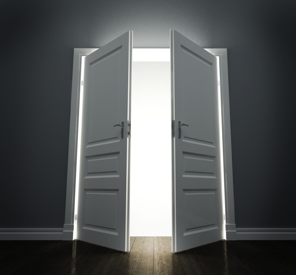Double doors opening with bright light shining through