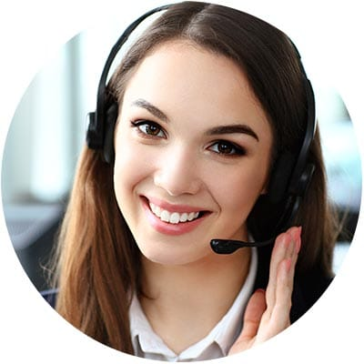 A young woman smiling and wearing a telephone headset.