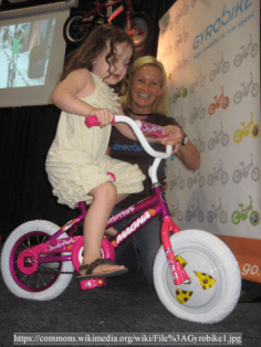 Gyrobike1 girl on bike public domain wiki PNG resized
