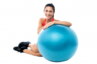 Woman Relaxing With Exercise Ball