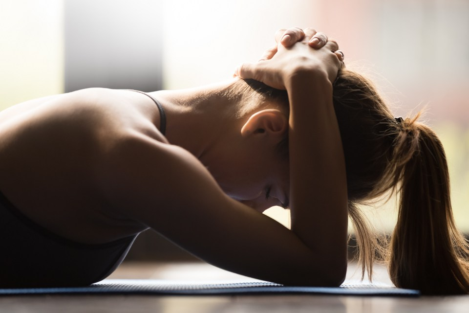 young woman practicing yoga