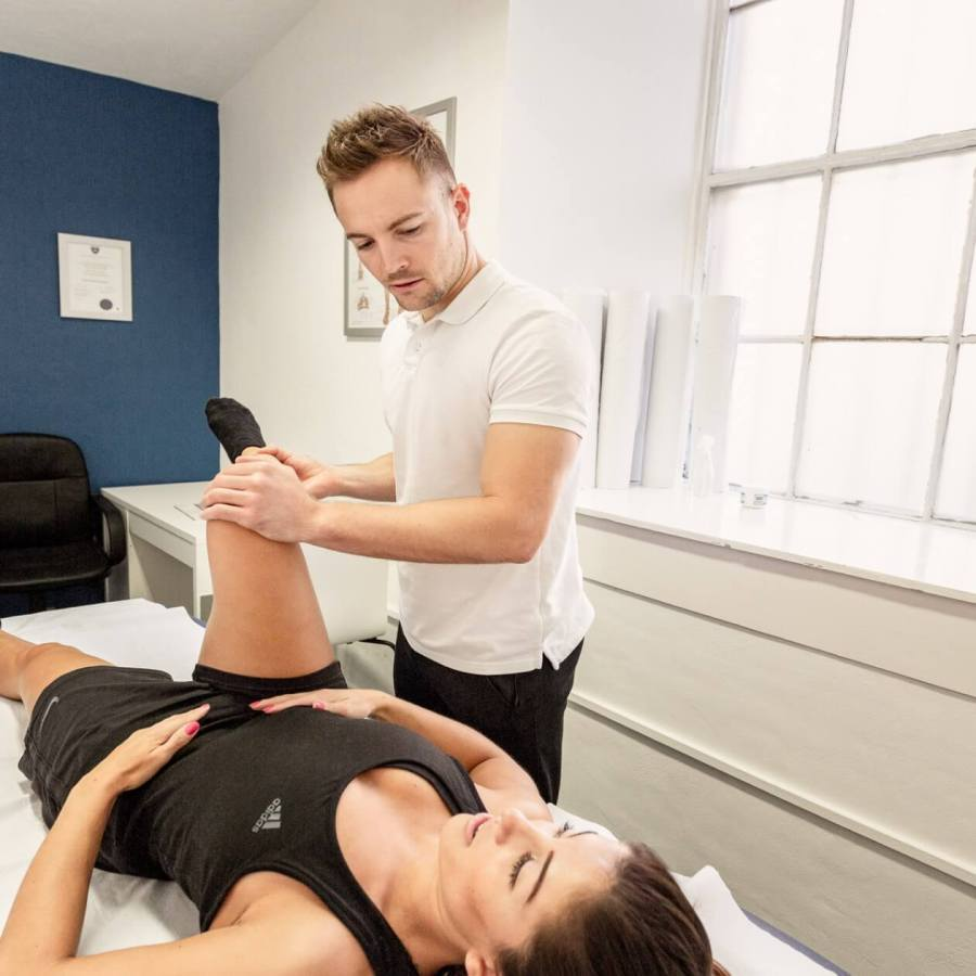 One of our physio's working with a female patient in our Edinburgh studio
