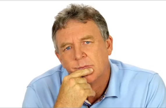 Middle Aged Man Pondering About Health Insurance