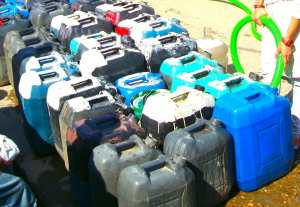 Colourful water containers that need to be filled up.
