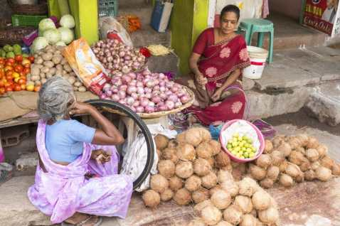 Illustrative image. Pondichery, Tamil Nadu, India - May 14, 2014. Vegetables and fruits market place, colored shops, sold by men or women