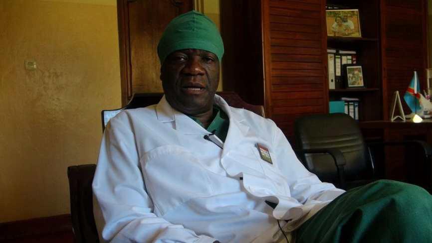 Dr Mukwege in his Panzi office. Credit: By PINAULT/VOA - VOA Français, http://www.lavoixdelamerique.com/content/mukwege-retour-cri-du-coeur-voa/1601847.html, Public Domain, https://commons.wikimedia.org/w/index.php?curid=24643155