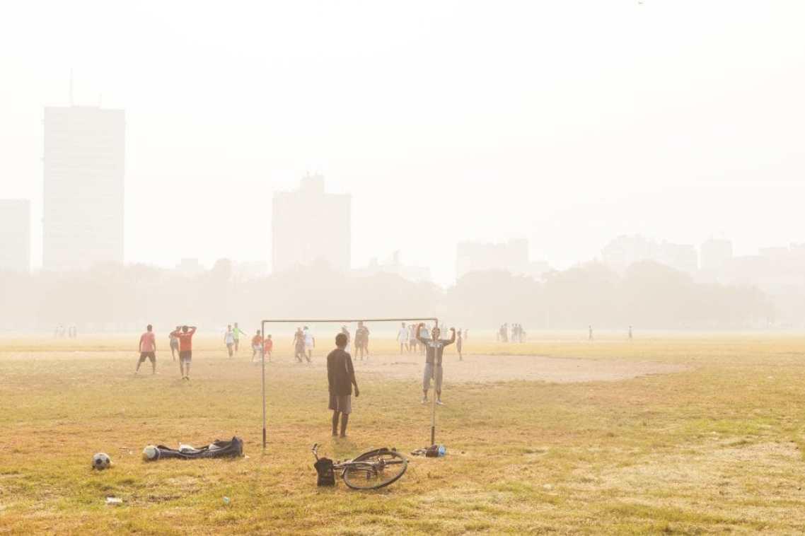 KOLKATA, INDIA - 22 Oct 2016: Boys play soccer on the Maidan on October 22, 2016 in Kolkata (Calcutta), India