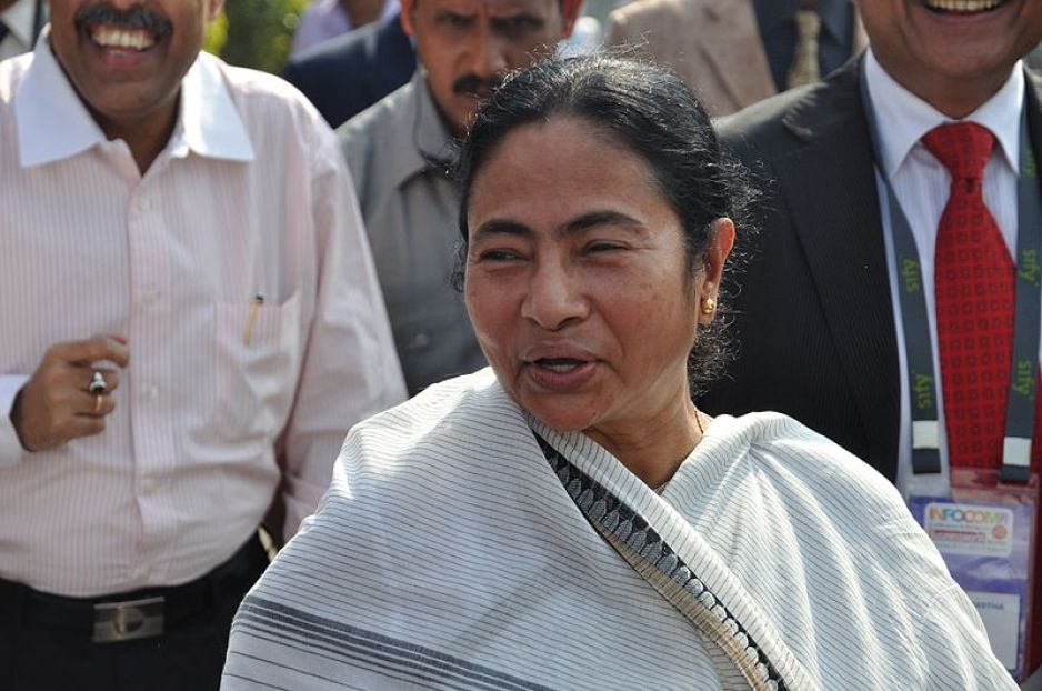 "Mamata Banerjee (Bengali: মমতা বন্দ্যোপাধ্যায়; Hindi: ममता बनर्जी, pronounced [mɔːmoːt̪ʰaː bɛːnaːrjiː]; born 5 January 1955) is the 11th and current chief minister of the Indian state of West Bengal. She is the first woman to hold the office. Banerjee founded All India Trinamool Congress in 1997 and became chairperson, after separating from the Indian National Congress. Currently she is also in charge of nine key departments of the government of West Bengal, including Home, Health and Family Welfare, Land and Land Reforms, Information and Cultural Affairs, Minority Affairs and Madrassah Education, Agriculture, Power and Home (Personnel and Administrative Reforms) departments. She is popularly referred to as ""Didi"" (meaning elder sister) to all her followers. This photograph has been taken during the inauguration of the 'Infocom 2011' exhibition at Milan mela ground, Kolkata."