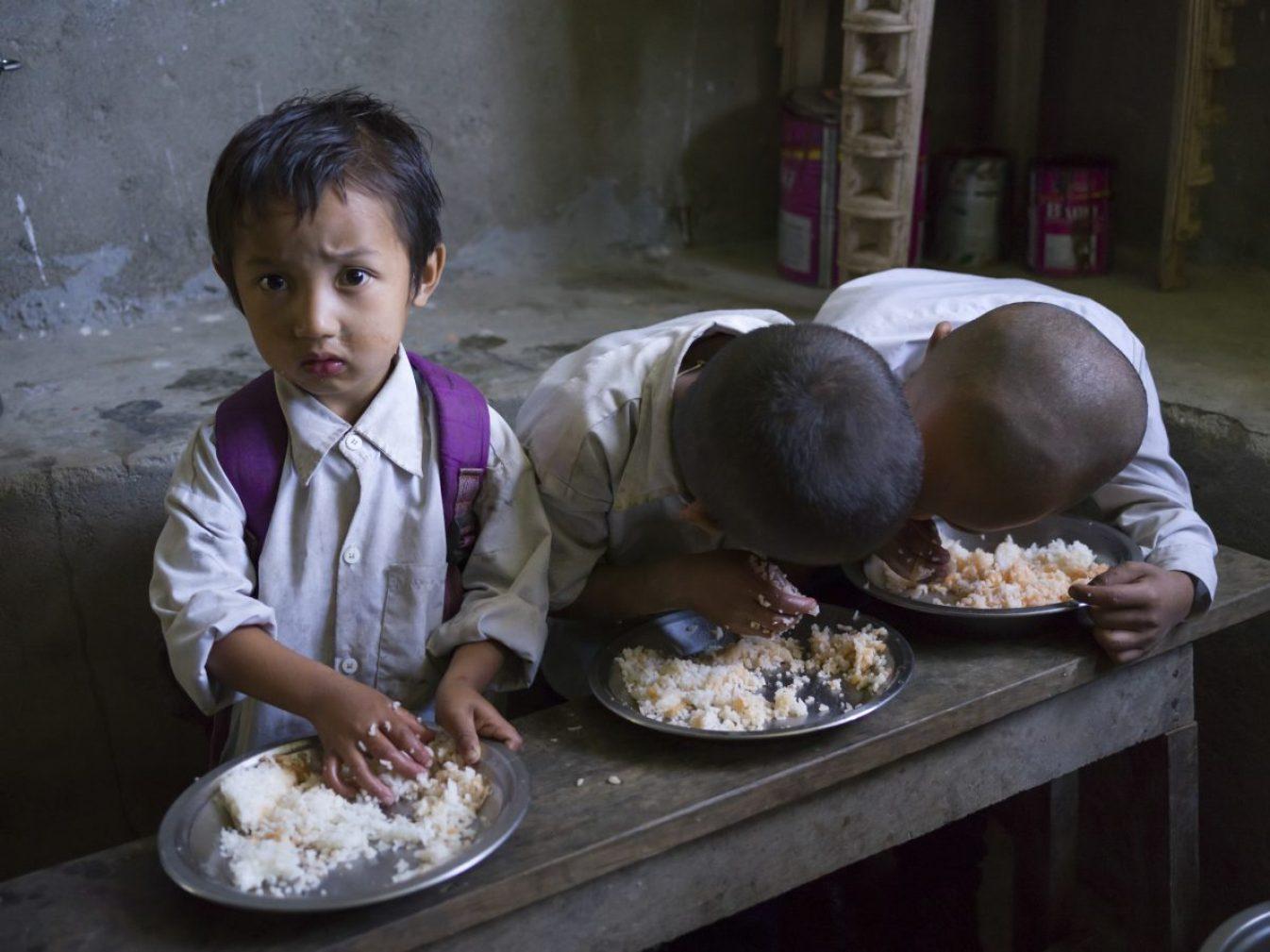 children.  School children having lunch at school, Radhu Khandu Village, Sikkim, India.  Image credit: Keith Levitt / 123rf.  Illustration of global hunger article.