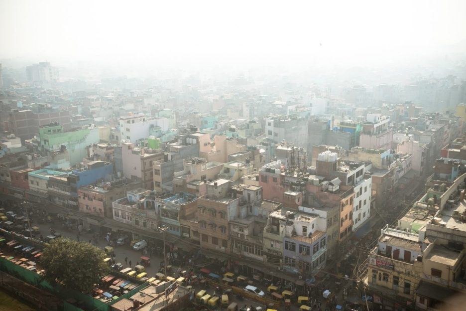 Top view of the city street in the poor quarter of new Delhi. Air pollution and smog in crowded cities.