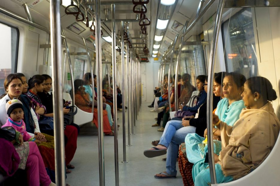 12592229 - delhi, india - february 03, 2012: women-only subway cars in delhi. delhi metro network consists of six lines with a total length of 189.63 kilometres (117.83 mi) with 142 stations