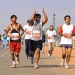 8945261 - delhi - october 28: men running on track at marathon on october 28th, 2007 in delhi, india.