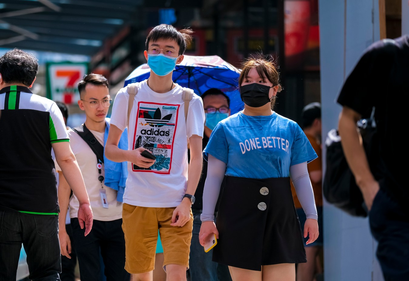 People wearing face coverings to protect against COVID. Concept. KUALA LUMPUR, MALAYSIA - FEBRUARY 22, 2020 : People wearing face mask to prevent infection of virus at Bukit Bintang. Bukit Bintang is a famous tourist attraction place. Image credit: Abdul Razak Latif / 123rf.
