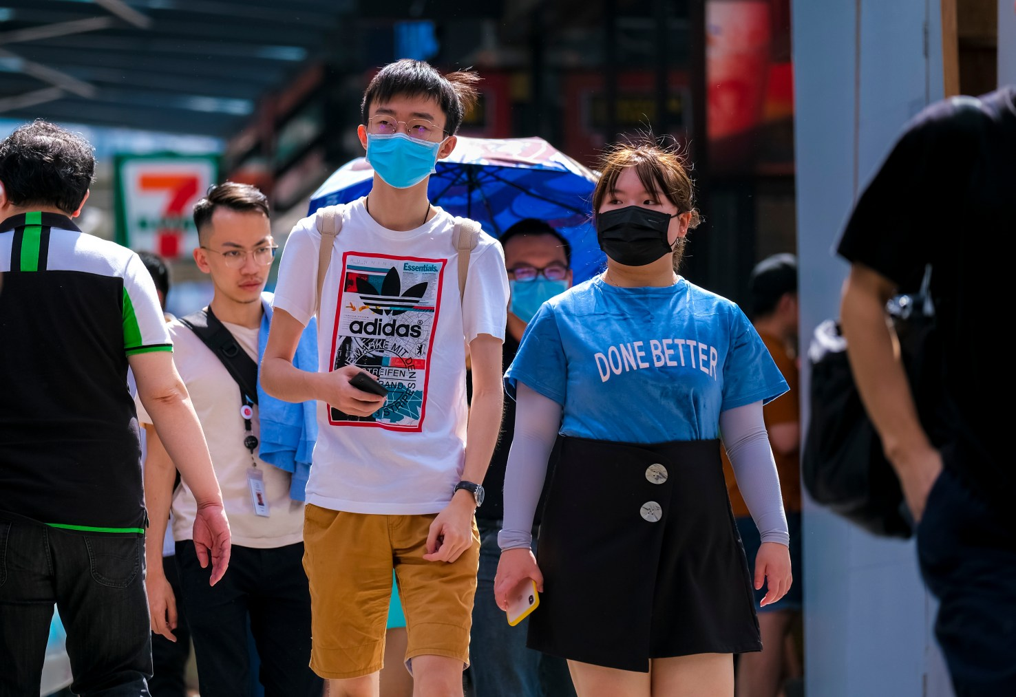 KUALA LUMPUR, MALAYSIA - FEBRUARY 22, 2020 : People wearing face mask to prevent infection of virus at Bukit Bintang. Bukit Bintang is a famous tourist attraction place.