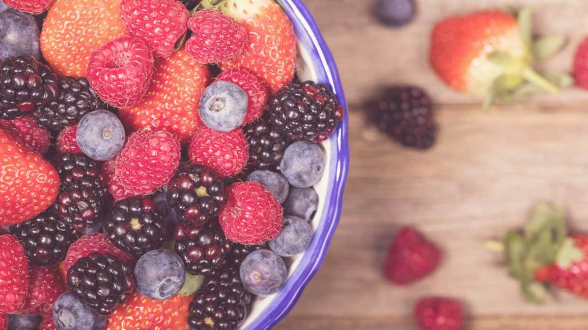 Berries in a Bowl on a Wooden Table