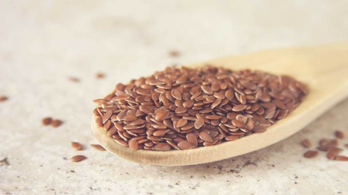 Flax Seeds on a Wooden Spoon