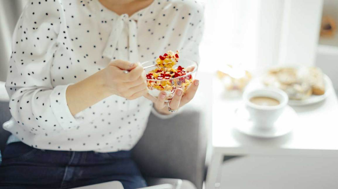 Woman Eating Cereal