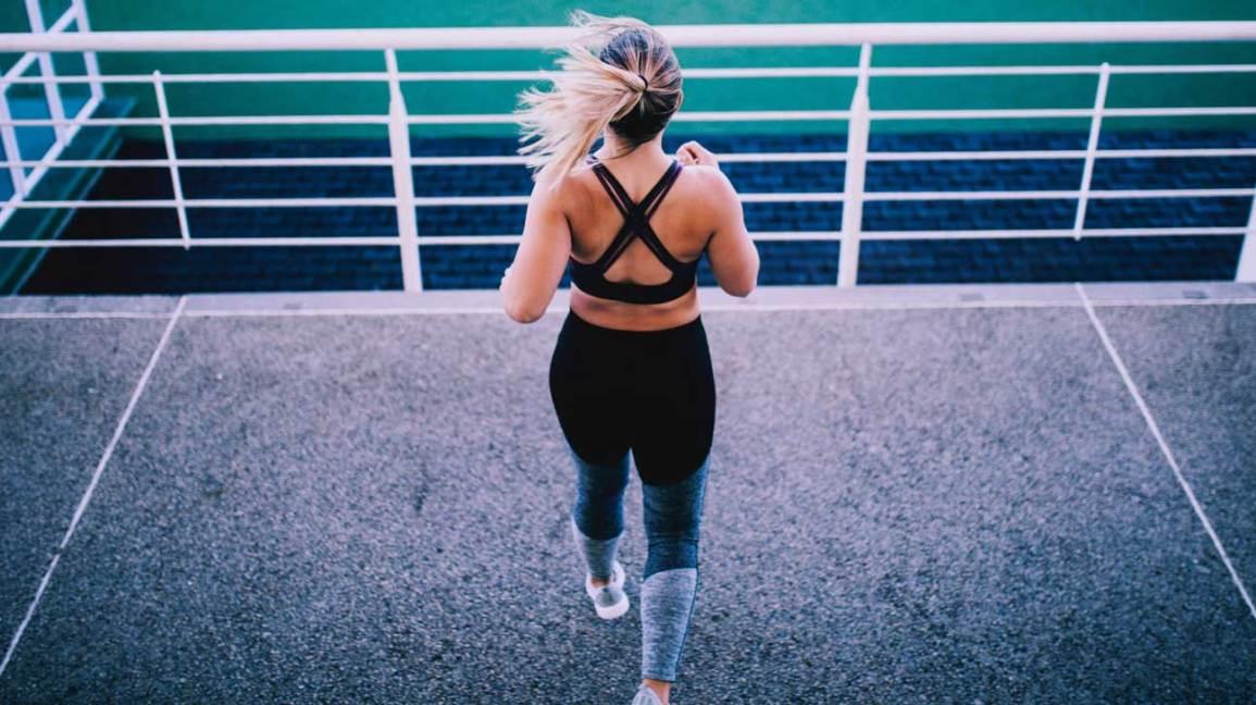 Woman Exercising At A Stadium