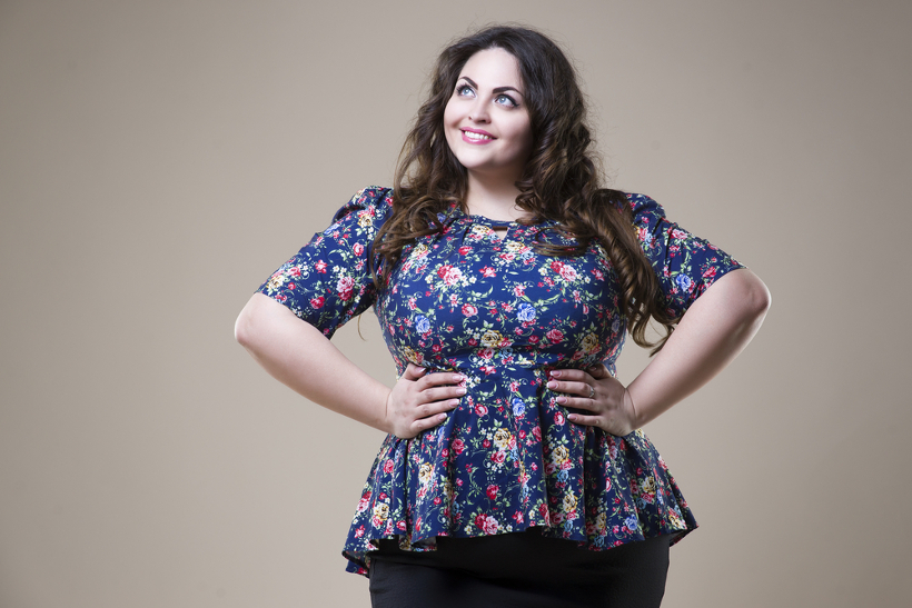 Smiling Plus Size Woman With Hands on Waist