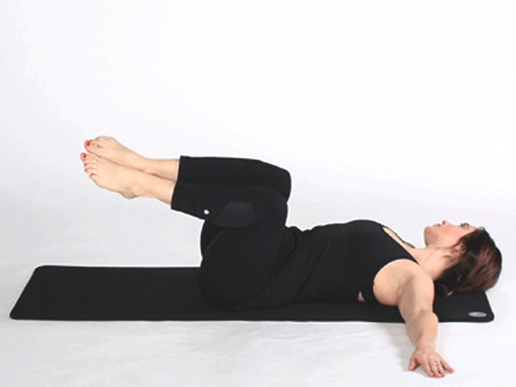 5ce266d7018 Do This Spinal Twist to Relax and Massage Your Gut