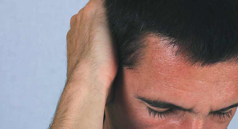 headache behind the ear