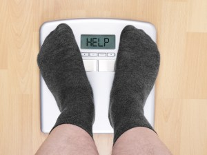 Man feet on weight loss scales