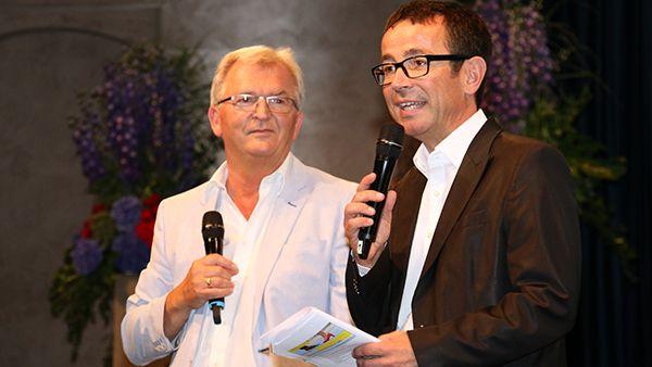 Prof. Dr. Johannes Einwag, Leiter des ZFZ Stuttgart, und Dr. Eberhard Montigel, Vorsitzender der DGDH, bei der Begrüßung.