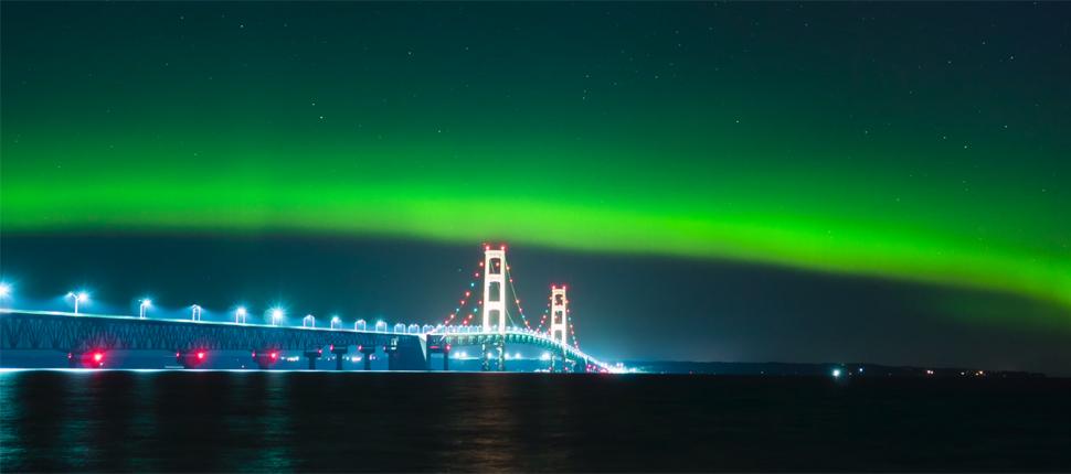 Northern Lights Shine Over The Mackinac Bridge In Michigan
