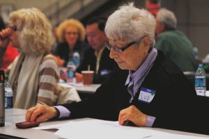Patient studying at patient forum