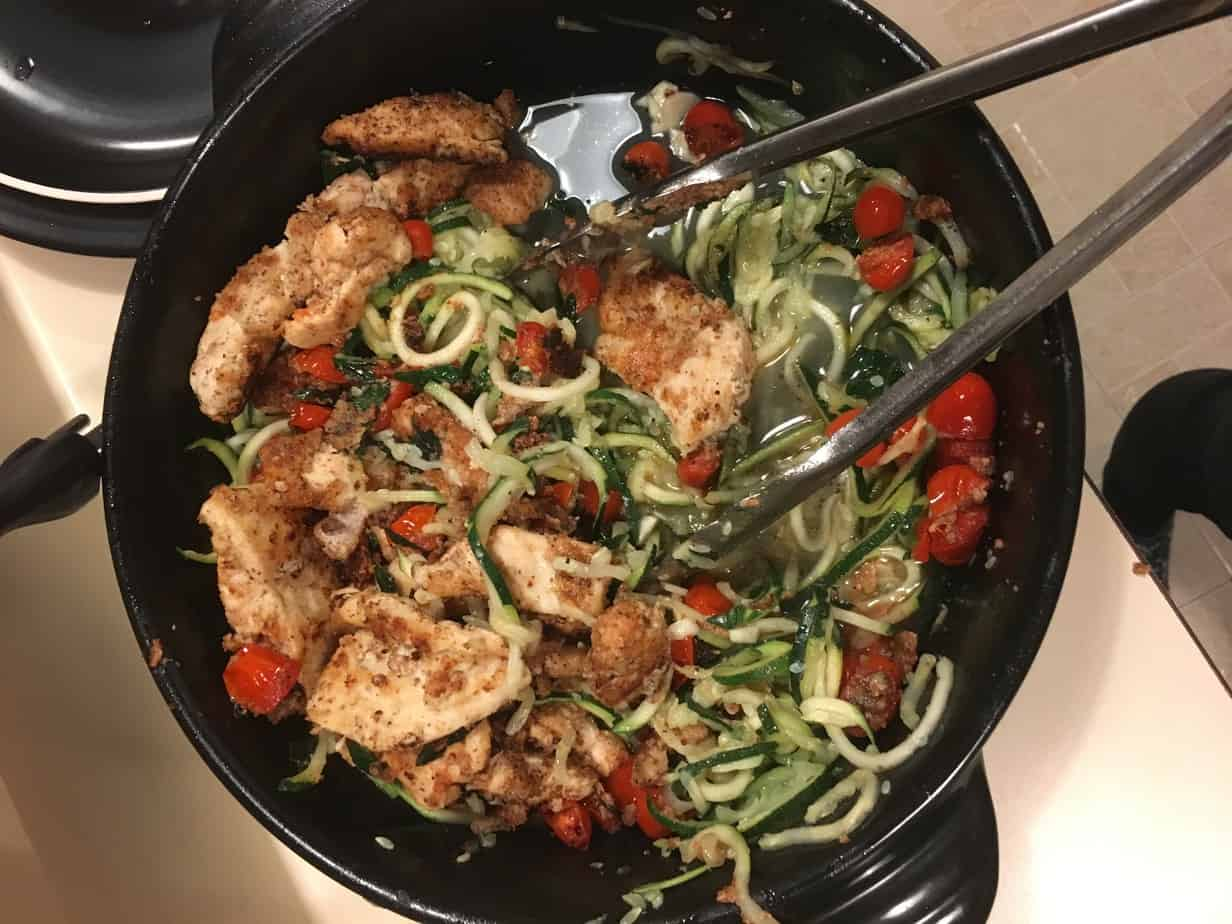 Almond flour-breaded chicken with zucchini noodles & cherry tomatoes