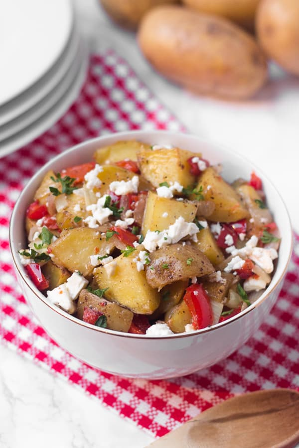This warm roasted potato salad has a light (mayo-free!) lemon and olive oil dressing, with lots of flavor from fresh roasted red pepper and salty feta cheese