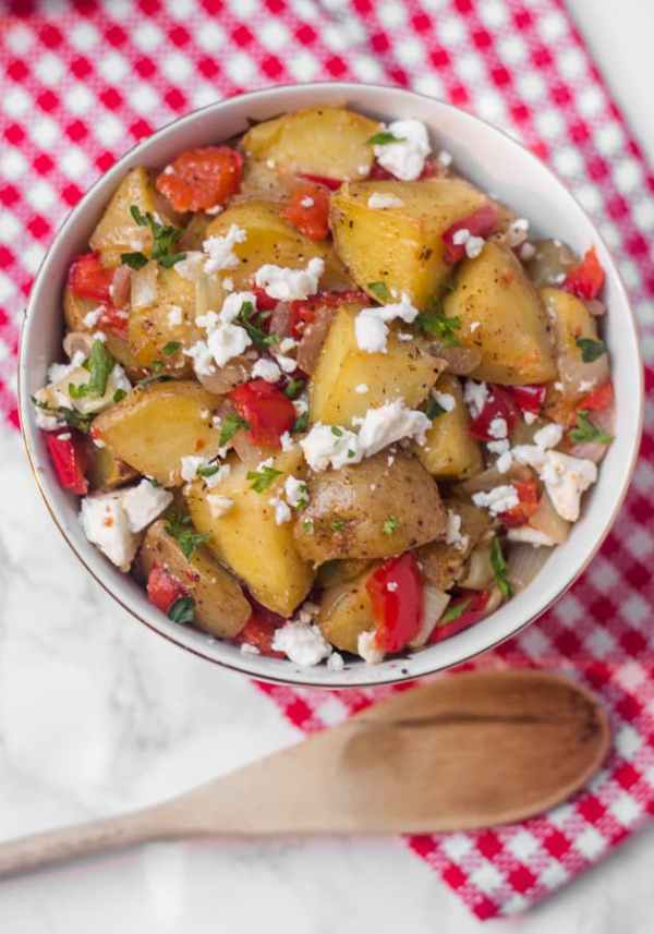 This warm roasted potato salad has a light (mayo-free!) lemon and olive oil dressing, with lots of flavor from roasted red pepper and salty feta
