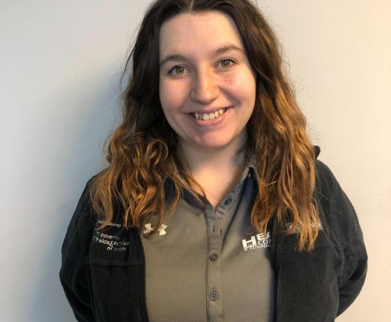 staff member smiling at camera