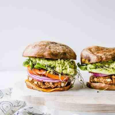 vegan bbq guacamole burger on sweet potato bun